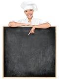 Chef-kok die menuteken toont Royalty-vrije Stock Foto
