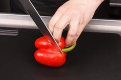 Chef-kok die voedsel voorbereidt Stock Foto's