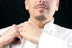Chef-kok Does Up Jacket Royalty-vrije Stock Fotografie