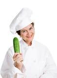 Chef-kok Holding Zucchini Stock Fotografie