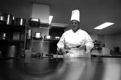 Chef-kok in keuken royalty-vrije stock foto