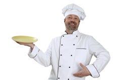 Chef-kok met een gele in hand kom en grote glimlach Stock Afbeelding