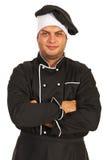 Chef-kok met gevouwen wapens stock afbeeldingen