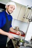 Chef-kok met lepel Stock Afbeelding