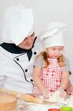 Chef-kok met meisje Stock Foto