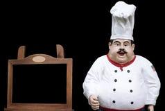 Chef-kok met zwarte raad voor menu Stock Afbeeldingen
