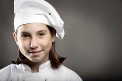 Chef-kok op grijze achtergrond Royalty-vrije Stock Foto's