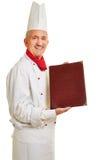 Chef-kokkok die menu aanbieden Royalty-vrije Stock Afbeelding