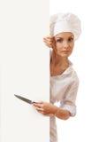 Chef-kokvrouw met lege raad voor haar Royalty-vrije Stock Foto's