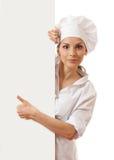 Chef-kokvrouw met lege raad voor haar Royalty-vrije Stock Foto