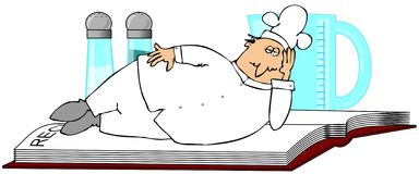 Chef Laying On A Recipe Book Stock Image