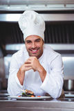 Chef leaning on the counter with a dish Stock Image