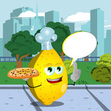 Chef lemon holding pizza with attitude in the city park with speech bubble Stock Photo