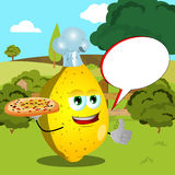 Chef lemon with pizza showing thumb up on a meadow with speech bubble Royalty Free Stock Images