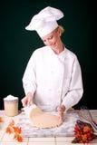 Chef lifting dough Royalty Free Stock Photo