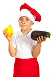 Chef little boy holding vegetables Stock Photography