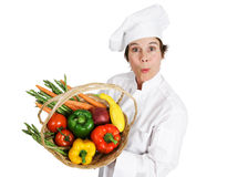 Chef - Locally Sourced Vegetables. Female chef holding a basket of fresh organic, locally sourced vegetables.  Isolated on white Stock Photo