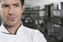 Chef Looking Away In Kitchen Royalty Free Stock Photo
