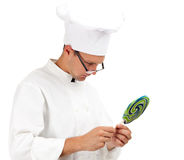 Chef  looking at colourful lollipop Royalty Free Stock Photo