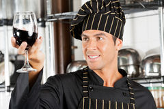 Chef Looking At Glass Of Red Wine Royalty Free Stock Photography