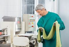 Chef Looking At Machine While Holding Spaghetti Royalty Free Stock Images