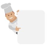 Chef looks out of behind the wall Royalty Free Stock Photo