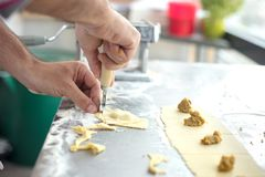 Chef prepared homemade raw tortellini pasta. Italian pasta,glut stock photography