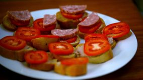 Chef makes sandwiches with pate, tomatoes, sausage stock video footage