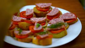 Chef makes sandwiches with pate, tomatoes, sausage stock video