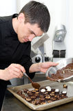 Chef makes sweets Stock Images