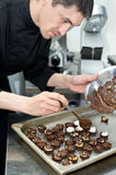 Chef makes sweets Royalty Free Stock Image