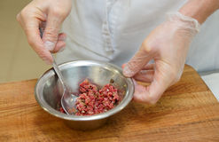 Chef is making beef tartare Royalty Free Stock Photo