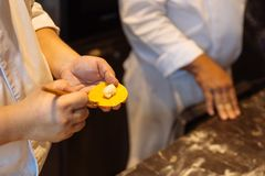 Chef making circle shape Ravioli by filling sage and butter on pasta dough.  stock photography