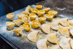 Chef making circle shape Ravioli by filling sage and butter on pasta dough.  stock image