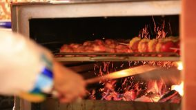 Chef is making flambe and fire until meat Is fried stock video footage