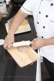 Chef making hamburger patty Stock Photo