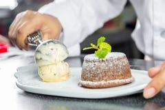 Chef making lava chocolate cake Royalty Free Stock Photo