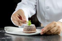 Chef making lava chocolate cake Stock Photography
