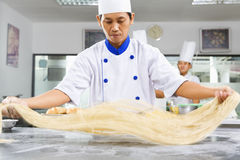 Chef making noodle Stock Images