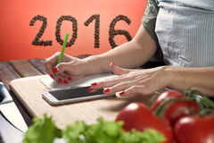 Chef is making notes in the recipe Royalty Free Stock Images