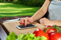 Chef is making notes in the recipe Royalty Free Stock Image