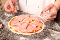 Chef making a Pizza Base Stock Photo