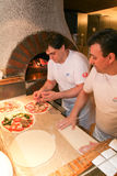 Chef making pizza at kitchen of a restaurant at Locarno Stock Photos