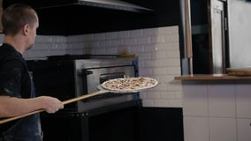 Chef making a pizza in modern italian restaurant stock video footage