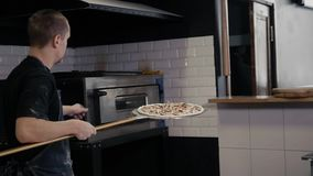Chef making a pizza in modern italian restaurant stock footage
