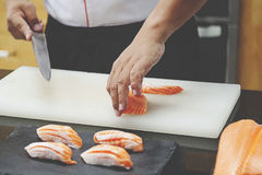 Chef making salmon sushi Royalty Free Stock Photography