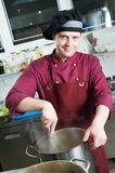 Chef making sauce Stock Photography