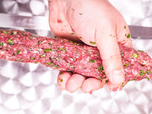A chef making shish kebab of red meat Royalty Free Stock Photography