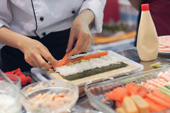 Chef making a sushi rolls Stock Photo