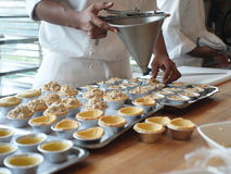 Chef making tarts stock images